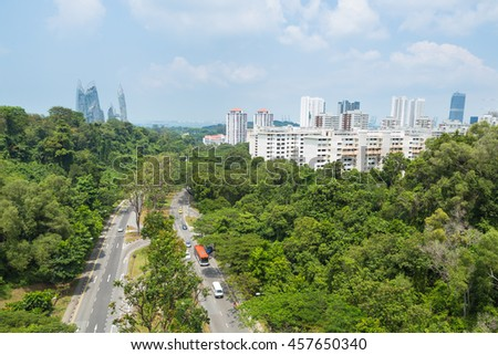 Road Park in Singapore. Road route into town There is a shady tree
