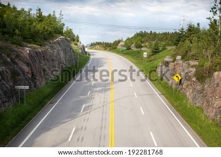 Road passing through landscape, Quebec, Canada - stock photo