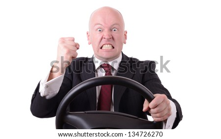 road rage behind the wheel with clenched fist isolated on white background - stock photo