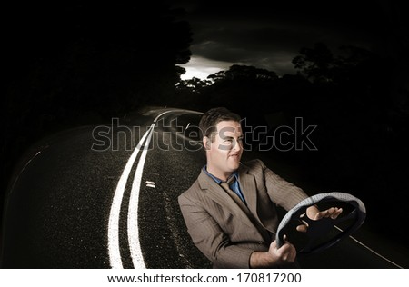 Road rage man beeping horn while behind the wheel of a vehicle on a dark road. Car accident - stock photo