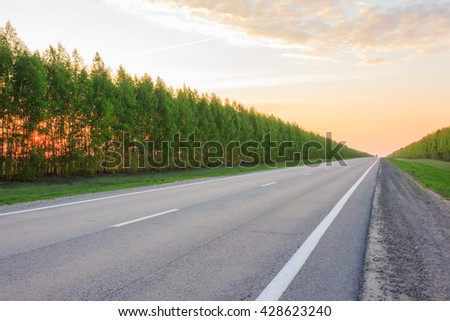road receding into the distance, becomes a point on the horizon - stock photo