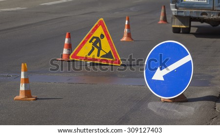 Road repairs and signs meaning a detour