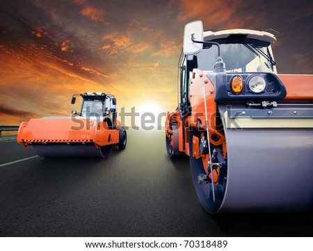 Road rollers for asphalt - stock photo