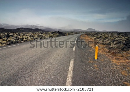 Road Round One, mountains and skies - stock photo