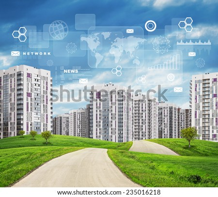 Road running through green hills with some trees on them towards high-rise buildings. Rectangles, diagrams and other virtual items in sky. - stock photo