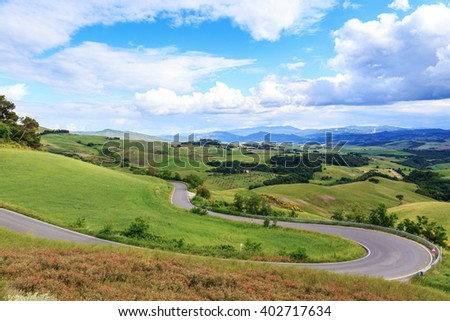 Road rural landscape of Tuscany and green rolling hills near Volterra, Italy. Europe.