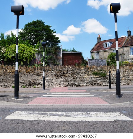 Road Safety Theme - Low Angle View of a Zebra Crossing - stock photo