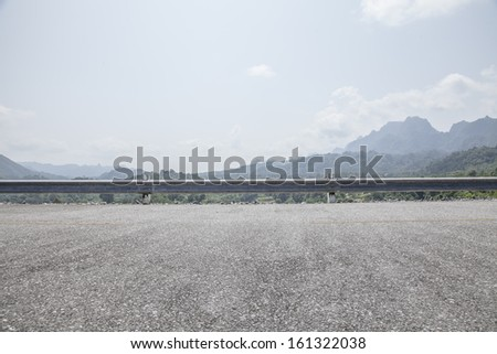 Road side mountain view background - stock photo