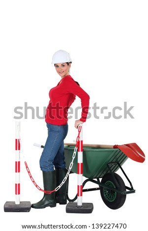 Road-side worker with wheelbarrow - stock photo