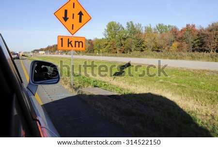 Road sign and autumn landscape, New England (USA) - stock photo