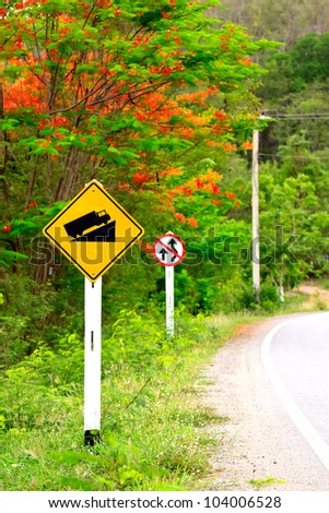 Road sign beside the main road go to the mountain - stock photo