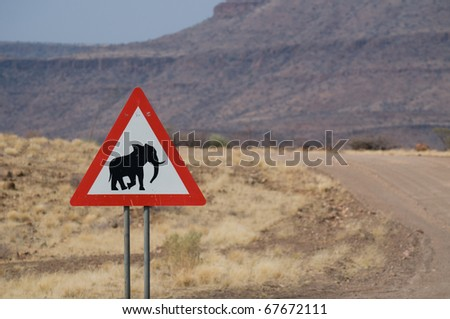 "Road sign, ""Caution crossing elephants"", Damaraland, Namibia - stock photo"