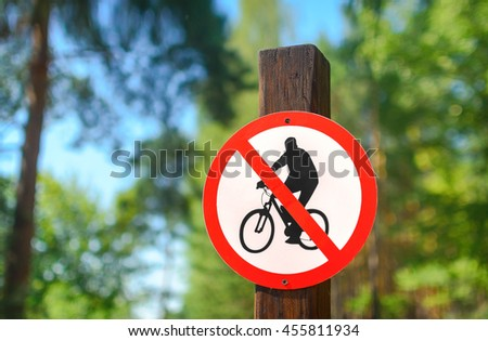 Road sign circular shape with a picture of the No Cycling on a background of summer forest - stock photo