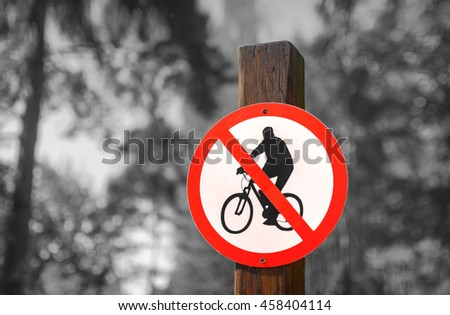 Road sign circular shape with a picture of the No Cycling on a black and white background of summer forest - stock photo