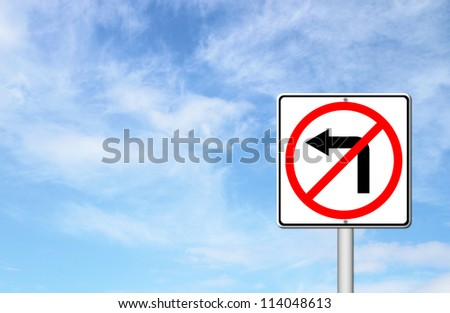 Road sign don't turn left over blue sky blank for text