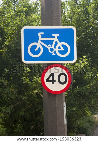 road sign for a cycle route and a speed limit