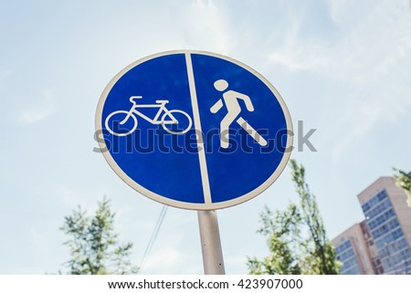 road sign for bikes and pedestrians path - stock photo