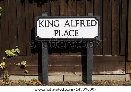 Road sign for one of the many streets named after the medieval King Alfred the Great in Winchester, England.