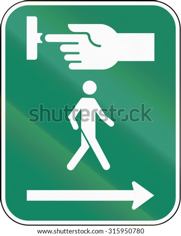 Road sign in Canada, instructing pedestrians to use the crosswalk signal. This sign is used in Quebec. - stock photo