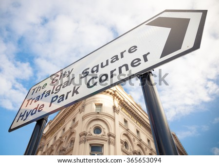 Road sign in Central London showing directions to Trafalgar Square and Hyde Park - stock photo