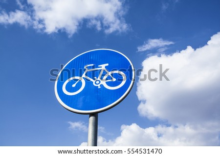 Road sign in Europe indicating a preference for cyclists