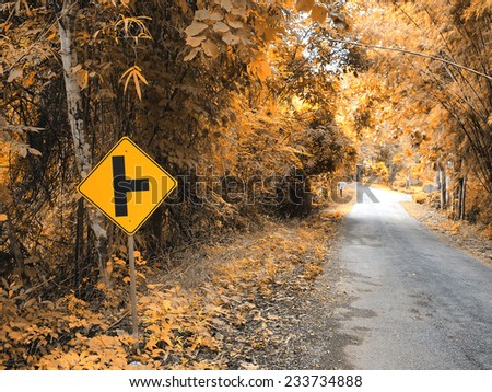 road sign in the forest and mountain - stock photo