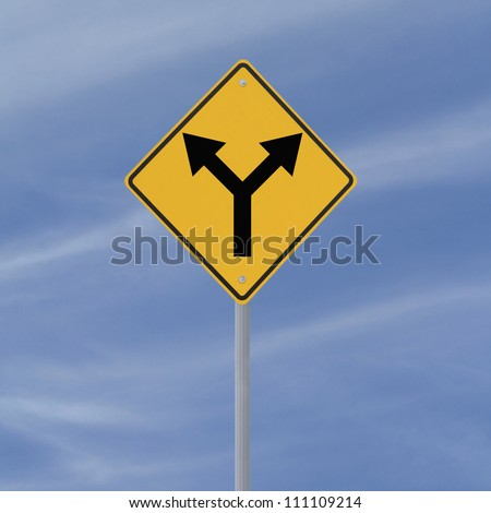 Road sign indicating a forked road ahead (against a blue sky background) - stock photo