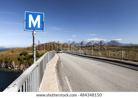 Road sign M stands for Meeting Point in Scandinavia. Photographed on one of the many narrow bridges in Helgeland, Norway