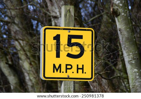 Road sign 15 miles per hour - stock photo
