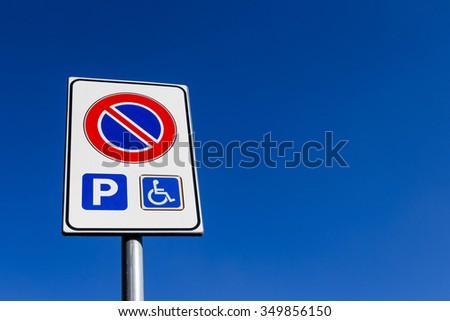 Road sign no parking, except for wearers handicap. - stock photo