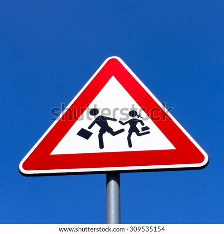 Road Sign of crosswalk of students, in vertical composition.