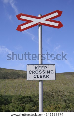Road Sign of Keep Crossing Clear