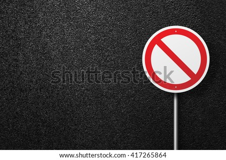 Road sign of the circular shape. Behind the sign one can see a smooth asphalt road. The texture of the tarmac, top view. - stock photo