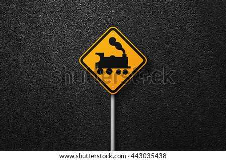 Road sign of the diamond shape on a background of asphalt. Railway. The texture of the tarmac, top view. - stock photo