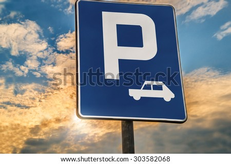 road sign Parking area or Rest stop against the evening sky - stock photo