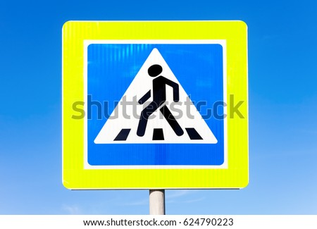 Road sign Pedestrian crossing against the blue sky background