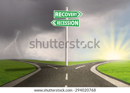 Road sign showing the way to recession and recovery  - stock photo