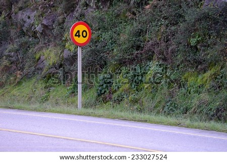 road sign speed limit 40 - stock photo