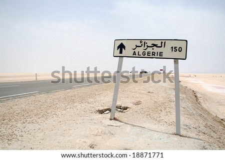 road sign to algeria - stock photo