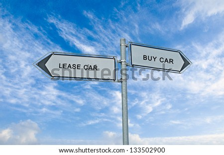 Road sign to lease and buy car - stock photo