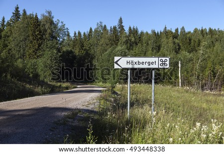 Road sign to the memorial, landmark of a witch trials, which took place in 1675 in Torsaker, Sweden. 71 people, 65 women and 6 men were beheaded and then burned.
