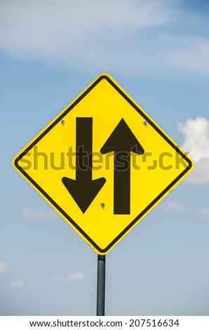 Road sign to warn drivers of two-way traffic ahead.   - stock photo