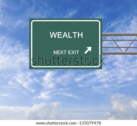 Road sign to wealth - stock photo