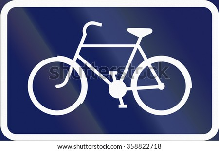 Road sign used in Sweden - Recommended route for pedal cycles and mopeds. - stock photo