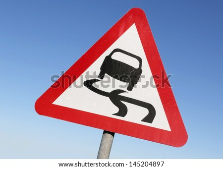 Road sign warning of slippery conditions.