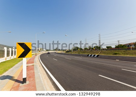 Road Sign warns Drivers to Beware Ahead Dangerous Curve. - stock photo