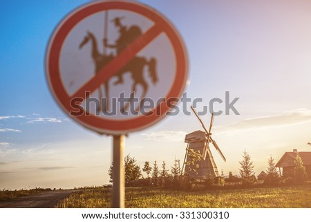 Road sign, which prohibits Don Quixote approach to the mill. - stock photo