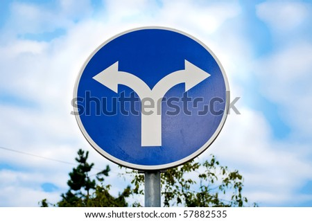 Road sign with opposite arrows - stock photo