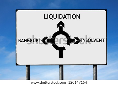 Road sign with roundabout directions pointing towards liquidation bankrupt and insolvent - stock photo