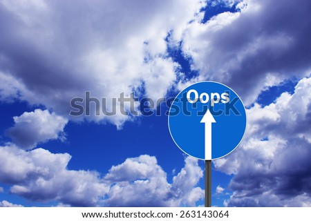 road sign with warning inscription oops on the background of blue sky - stock photo